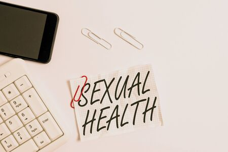 Text sign showing Sexual Health. Business photo showcasing Healthier body Satisfying Sexual life Positive relationships White pc keyboard with empty note paper above white background and mobile phone