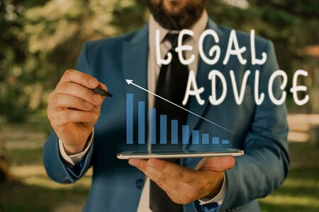 Word writing text Legal Advice. Business photo showcasing Lawyer opinion about law procedure in a particular situation Male human wear formal work suit presenting presentation using smart device