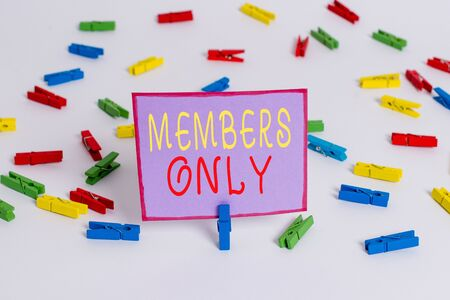 Conceptual hand writing showing Members Only. Concept meaning Limited to an individual belongs to a group or an organization Colored clothespin papers empty reminder white floor office
