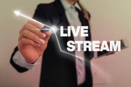 Text sign showing Live Stream. Business photo text transmit or receive video and audio coverage over Internet 写真素材