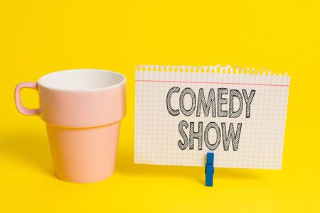 Writing note showing Comedy Show. Business concept for Funny program Humorous Amusing medium of Entertainment Cup empty paper blue clothespin rectangle shaped reminder yellow office