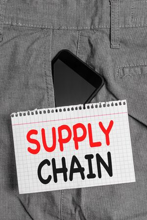 Handwriting text Supply Chain. Conceptual photo System of organization and processes from supplier to consumer Smartphone device inside formal work trousers front pocket near note paper Foto de archivo - 130153140