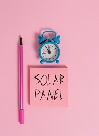 Text sign showing Solar Panel. Business photo text designed to absorb suns rays source of energy generating Metal vintage alarm clock wakeup blank notepad marker colored background