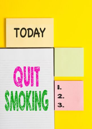 Word writing text Quit Smoking. Business photo showcasing Discontinuing or stopping the use of tobacco addiction Colored empty papers with copy space on the yellow background table