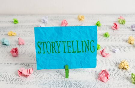 Word writing text Storytelling. Business photo showcasing social and cultural Activity with Theatrical Gestures Green clothespin white wood background colored paper reminder office supply Reklamní fotografie