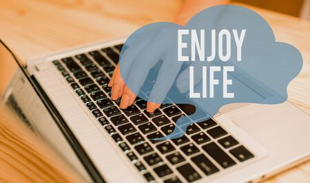 Conceptual hand writing showing Enjoy Life. Concept meaning Any thing, place,food or demonstrating, that makes you relax and happy woman with laptop smartphone and office supplies technology Banco de Imagens