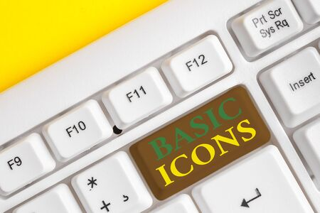 Handwriting text Basic Icons. Conceptual photo pictogram or ideogram displayed on a computer screen or phone White pc keyboard with empty note paper above white background key copy space