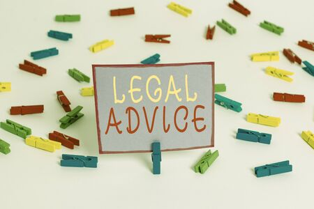 Conceptual hand writing showing Legal Advice. Concept meaning Lawyer opinion about law procedure in a particular situation Colored clothespin papers empty reminder white floor office