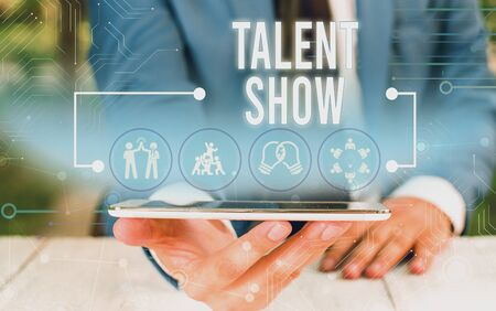 Word writing text Talent Show. Business photo showcasing Competition of entertainers show casting their perforanalysisces Male human wear formal work suit presenting presentation using smart device