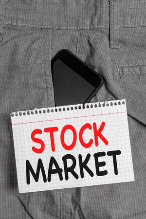 Handwriting text Stock Market. Conceptual photo Particular market where stocks and bonds are traded or exhange Smartphone device inside formal work trousers front pocket near note paper