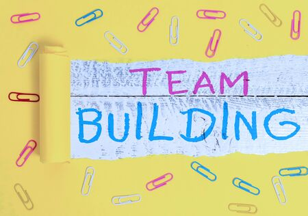 Writing note showing Team Building. Business concept for Types of activities used to enhance social relations Stock Photo