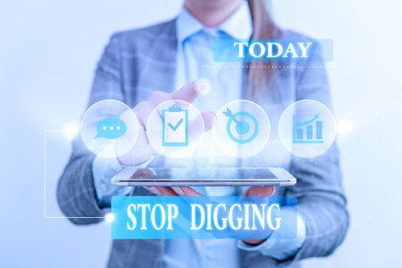 Word writing text Stop Digging. Business photo showcasing Prevent Illegal excavation quarry Environment Conservation Female human wear formal work suit presenting presentation use smart device