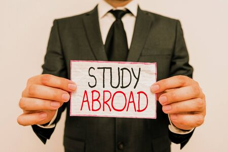 Handwriting text Study Abroad. Conceptual photo Pursuing educational opportunities in a foreign country Фото со стока - 130184972