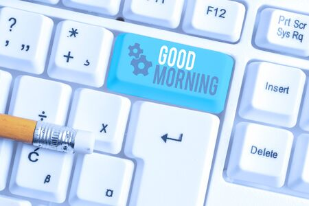 Writing note showing Good Morning. Business concept for A conventional expression at meeting or parting in the morning White pc keyboard with note paper above the white background