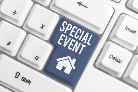 Conceptual hand writing showing Special Event. Concept meaning Function to generate money for non profit a Crowded Occassion White pc keyboard with note paper above the white background Banco de Imagens