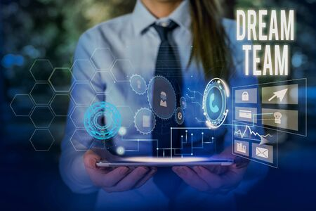 Writing note showing Dream Team. Business concept for Prefered unit or group that make the best out of a demonstrating Woman wear formal work suit presenting presentation using smart device