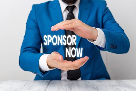 Writing note showing Sponsor Now. Business concept for paying or investing in project with no profit back for you Man holds empty paper with copy space in front of him Space Stok Fotoğraf