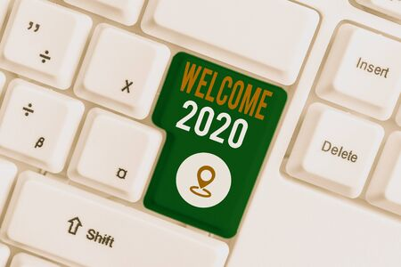 Word writing text Welcome 2020. Business photo showcasing New Year Celebration Motivation to Start Cheers Congratulations White pc keyboard with empty note paper above white background key copy space