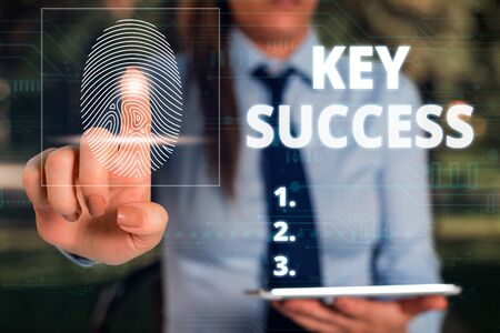 Word writing text Key Success. Business photo showcasing generally three to five areas that company may focus on Woman wear formal work suit presenting presentation using smart device