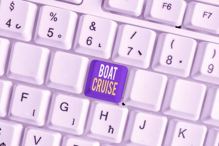 Conceptual hand writing showing Boat Cruise. Concept meaning sail about in area without precise destination with large ship White pc keyboard with note paper above the white background