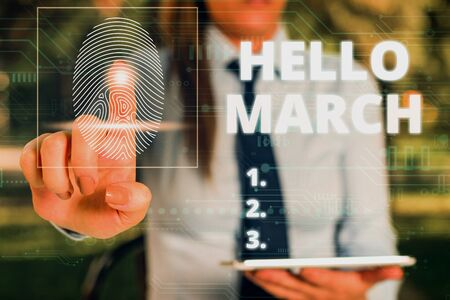 Word writing text Hello March. Business photo showcasing musical composition usually in duple or quadruple with beat Woman wear formal work suit presenting presentation using smart device