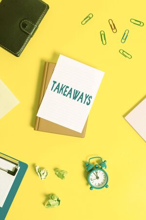 Text sign showing Takeaways. Business photo showcasing An act or instance of giving something from you to someone Pile of empty papers with copy space on the table Stok Fotoğraf