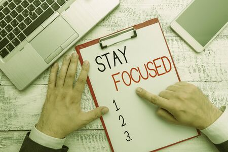 Writing note showing Stay Focused. Business concept for Be attentive Concentrate Prioritize the task Avoid distractions Stock Photo