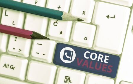 Writing note showing Core Values. Business concept for belief demonstrating or organization views as being importance White pc keyboard with note paper above the white background