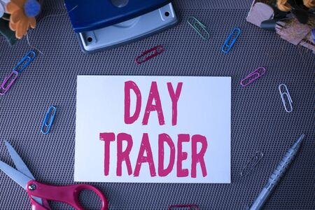 Handwriting text Day Trader. Conceptual photo A demonstrating that buy and sell financial instrument within the day Scissors and writing equipments plus plain sheet above textured backdrop Stok Fotoğraf