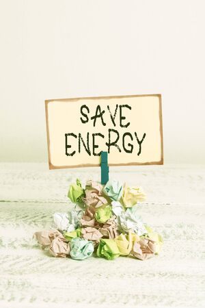 Writing note showing Save Energy. Business concept for decreasing the amount of power used achieving a similar outcome Reminder pile colored crumpled paper clothespin wooden space