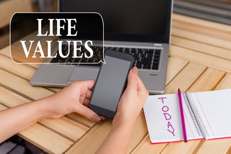 Word writing text Life Values. Business photo showcasing things that you believe are important in the way you live woman laptop computer smartphone office supplies technological devices Zdjęcie Seryjne