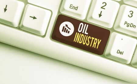 Writing note showing Oil Industry. Business concept for Exploration Extraction Refining Marketing petroleum products White pc keyboard with note paper above the white background