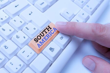 Text sign showing South America. Business photo showcasing Continent in Western Hemisphere Latinos known for Carnivals White pc keyboard with empty note paper above white background key copy space Banco de Imagens
