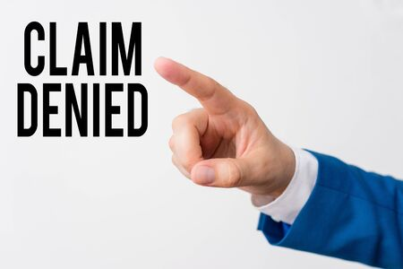Writing note showing Claim Denied. Business concept for Requested reimbursement payment for bill has been refused Isolated hand pointing with finger. Business concept pointing finger 版權商用圖片
