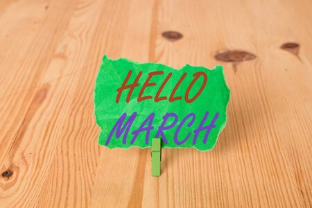 Text sign showing Hello March. Business photo showcasing musical composition usually in duple or quadruple with beat Empty reminder wooden floor background green clothespin groove slot office