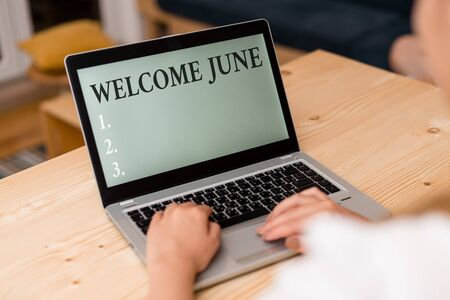 Word writing text Welcome June. Business photo showcasing Calendar Sixth Month Second Quarter Thirty days Greetings woman laptop computer smartphone mug office supplies technological devices