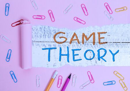 Writing note showing Game Theory. Business concept for branch of mathematics concerned with analysis of strategies