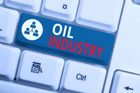 Text sign showing Oil Industry. Business photo showcasing Exploration Extraction Refining Marketing petroleum products White pc keyboard with empty note paper above white background key copy space