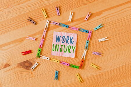 Text sign showing Work Injury. Business photo showcasing Accident in job Danger Unsecure conditions Hurt Trauma Colored clothespin papers empty reminder wooden floor background office 版權商用圖片