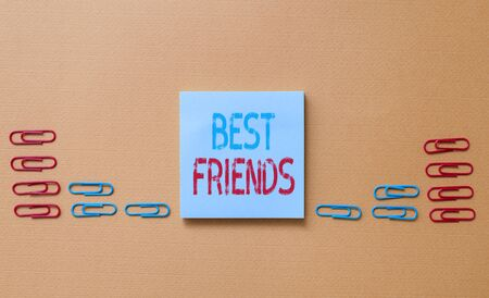 Word writing text Best Friends. Business photo showcasing A demonstrating you value above other demonstratings Forever buddies Colored blank sticky note clips gathered trendy cool pastel background Imagens