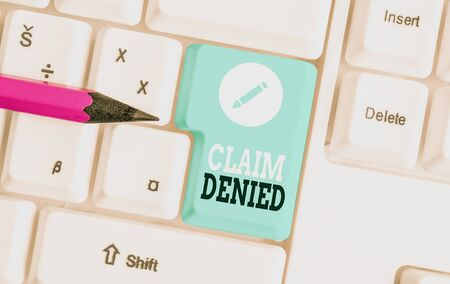 Word writing text Claim Denied. Business photo showcasing Requested reimbursement payment for bill has been refused White pc keyboard with empty note paper above white background key copy space