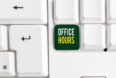 Conceptual hand writing showing Office Hours. Concept meaning The hours which business is normally conducted Working time White pc keyboard with note paper above the white background 스톡 콘텐츠