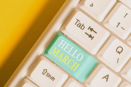 Word writing text Hello March. Business photo showcasing musical composition usually in duple or quadruple with beat White pc keyboard with empty note paper above white background key copy space