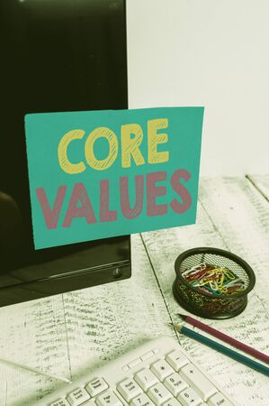 Writing note showing Core Values. Business concept for belief demonstrating or organization views as being importance Note paper taped to black computer screen near keyboard and stationary Imagens