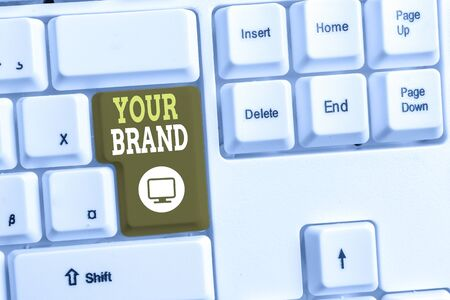 Text sign showing Your Brand. Business photo text A name of any kind that is impacted to something as trademark White pc keyboard with empty note paper above white background key copy space