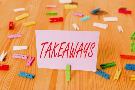 Handwriting text Takeaways. Conceptual photo An act or instance of giving something from you to someone Colored clothespin papers empty reminder wooden floor background office Stok Fotoğraf