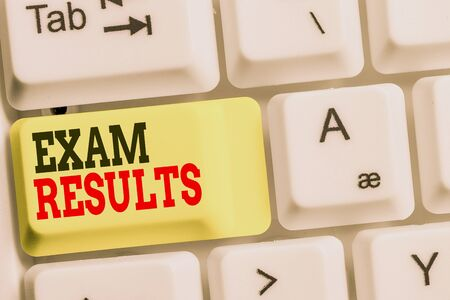 Handwriting text Exam Results. Conceptual photo An outcome of a formal test that shows knowledge or ability White pc keyboard with empty note paper above white background key copy space