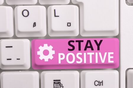 Writing note showing Stay Positive. Business concept for Engage in Uplifting Thoughts Be Optimistic and Real White pc keyboard with note paper above the white background