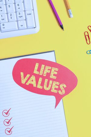 Text sign showing Life Values. Business photo showcasing things that you believe are important in the way you live Pink empty paper on the yellow table with pencil Stock Photo