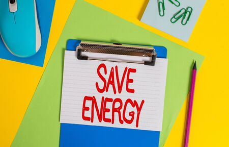 Word writing text Save Energy. Business photo showcasing decreasing the amount of power used achieving a similar outcome Clipboard striped sheets marker clips notepad mouse colored background Zdjęcie Seryjne